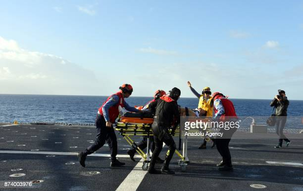 Paramedics pretend to carry an injured man on a stretcher as part of the military exercise on TCG Bayraktar navy vessel during Eastern Mediterranean...