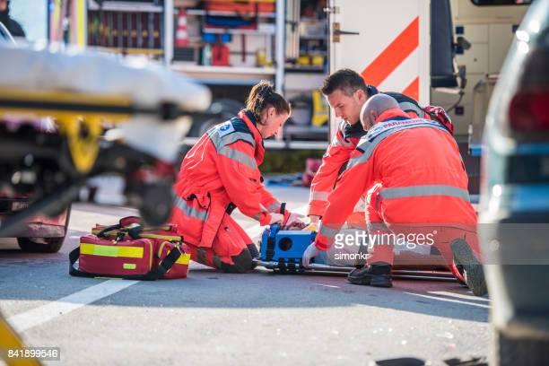 Paramedics providing first aid