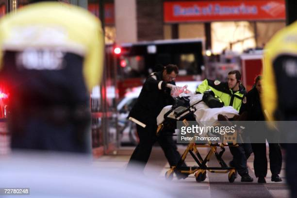 Paramedics remove an injured person from the Ogilvie Transportation Center part of the Citigroup Center office building after a gunman shot four...