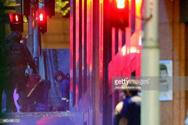 Paramedics resuscitating casualties at Lindt Cafe Martin Place following a hostage standoff on December 16 2014 in Sydney Australia Police stormed...