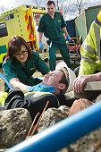 Paramedics see to injured builder