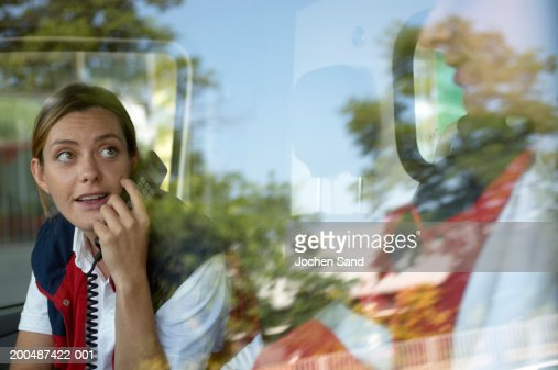 Paramedics sitting in ambulance, female using telephone : Foto de stock