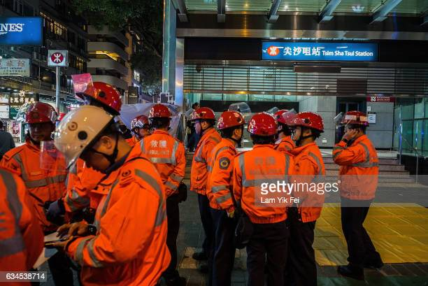 Paramedics standby at Tsim Sha Tsui MTR station on February 10 2017 in Hong Kong A 60 yearold man set a fire with a fuelfilled bottle as the train...