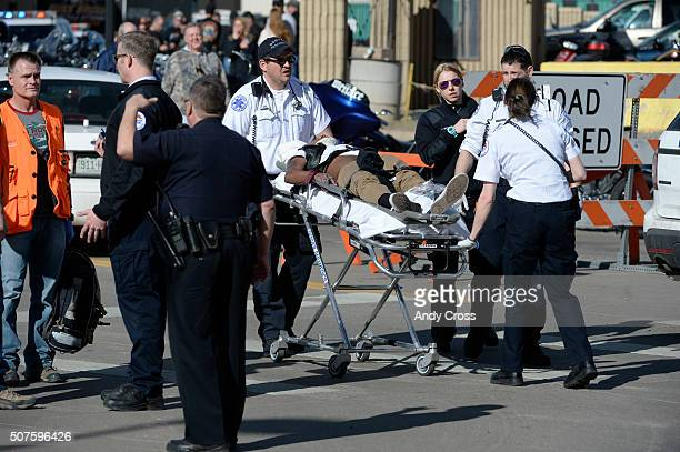 Paramedics transport a man to an awaiting ambulance at the National Western Stock Show complex January 30 2016 Denver Police reported a shooting and...