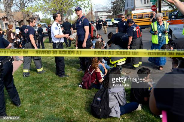 Paramedics work on kids at 39th Tejon after their school bus they were in was hit by a Jeep Grand Cherokee on April 13 2017 Some of the kids were...