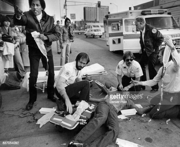 Paramedics work to save the life of Stanley W Quintana who was shot in a traffic altercation on Oct 30 1980 Quintana had angered the driver of a van...