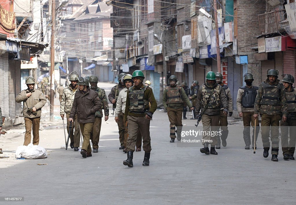 Paramilatary soldiers and policemen patroling the street on the 3rd day of curfew on February 11, 2013 in Srinagar, India. Kashmir Valley remained under curfew for the third day today even as mobile and Internet services remained suspended following hanging of Parliament attack convict Mohammad Afzal Guru.