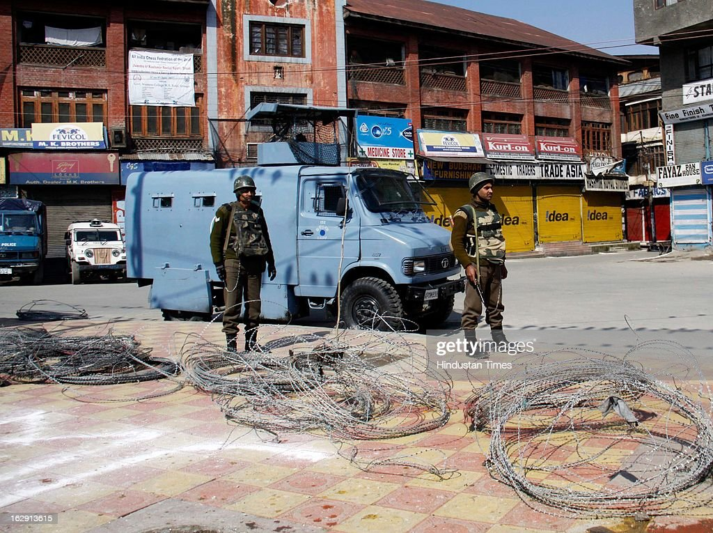 Paramilatary soldiers stand guard during a strike, on March 1, 2013 in Srinagar, India. As Kashmir valley observed a strike called by separatists in support of their demand for return of mortal remains of Parliament attack convict Afzal Guru .