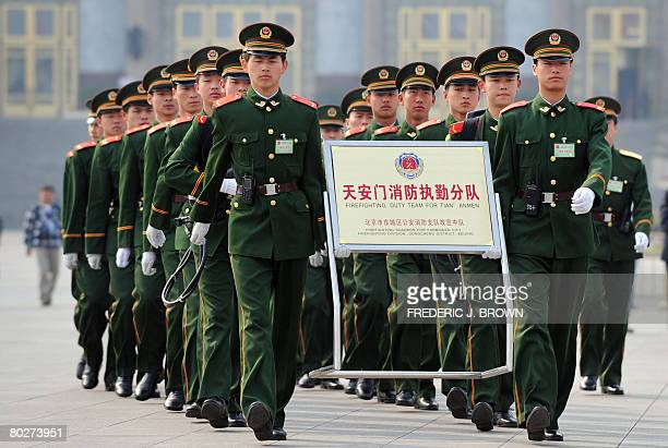 A paramilitary fire brigade march in front of the Great Hall of the People as delegates attend a session of the National People's Congress China's...