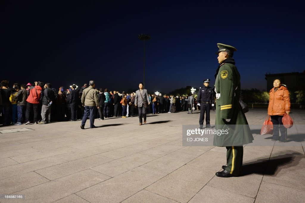 A paramilitary guard stands on Tiananmen Square as tourists arrive to watch the daily flag-raising ceremony on October 23, 2012. Supporters of disgraced politician Bo Xilai have published a letter on a leftist website urging him not to be expelled from China's parliament which would pave the way for him to face trial over alleged corruption and charges. AFP PHOTO / Ed Jones