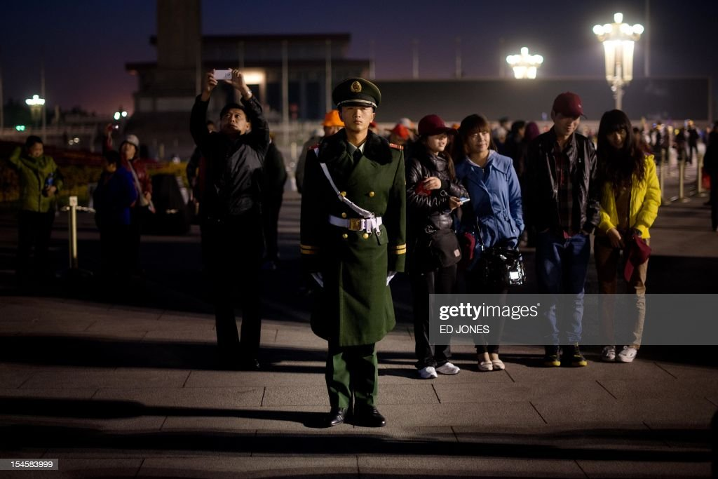 A paramilitary guard stands on Tiananmen Square as tourists arrive to watch the daily flag-raising ceremony early on October 23, 2012. Supporters of disgraced politician Bo Xilai have published a letter on a leftist website urging him not to be expelled from China's parliament which would pave the way for him to face trial over alleged corruption and charges. AFP PHOTO / Ed Jones