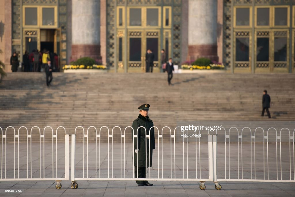 A paramilitary guard stands outside the Great Hall of the People prior to the unveiling of a new Politburo Standing Committee in Beijing on November 15, 2012. Xi Jinping is set to take the reins of China's all-powerful Communist Party in a leadership transition that will put him in charge of the world's number two economy for the next decade. AFP PHOTO / Ed Jones