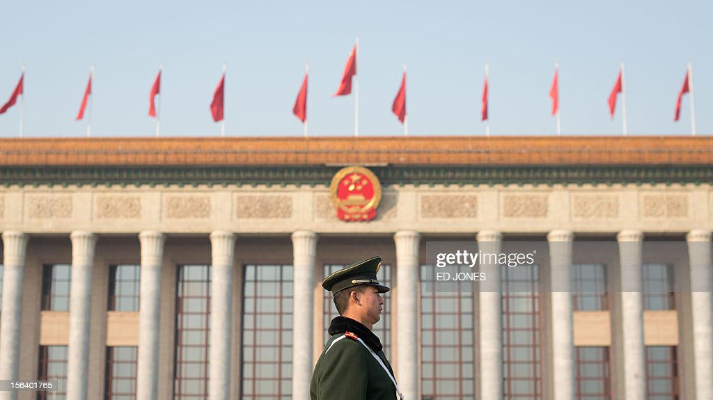 A paramilitary guard stands outside the Great Hall of the People prior to the unveiling of a new Politburo Standing Committee, in Beijing on November 15, 2012. Xi Jinping is set to take the reins of China's all-powerful Communist Party in a leadership transition that will put him in charge of the world's number two economy for the next decade. AFP PHOTO / Ed Jones
