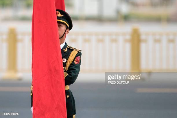 TOPSHOT A paramilitary guard stands prior to a welcome ceremony with Chinese President Xi Jinping and Serbian President Tomislav Nikolic at the Great...