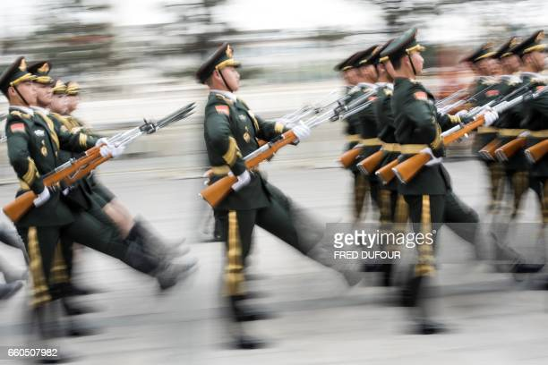 TOPSHOT Paramilitary guards prepare for a welcome ceremony with Chinese President Xi Jinping and Serbian President Tomislav Nikolic at the Great Hall...