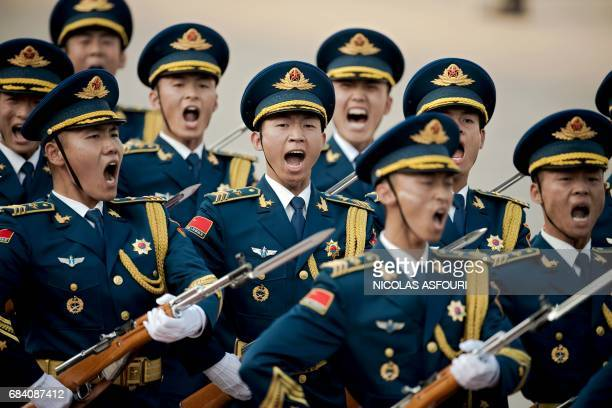 Paramilitary guards shout during a welcoming ceremony for Argentine President Mauricio Macri outside the Great Hall of the People in Beijing on May...