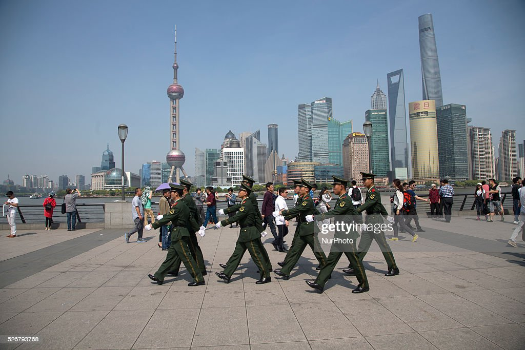 Paramilitary guards walk by the Bund during the Labour Day holidays in Shanghai on May 1 2016.