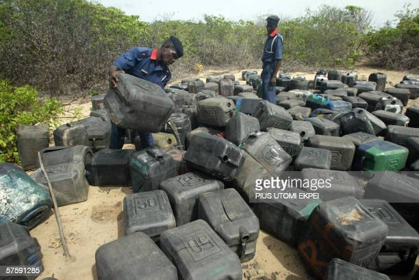 Paramilitary officers tries to empty the fuel in more 500 jerry can brought by the scoopers to steal fuel from the pipeline before it exploded...