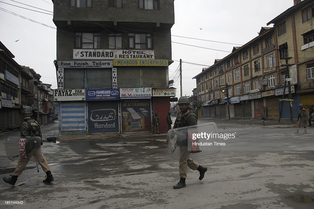 Paramilitary personnel patrolling during curfew in entire valley to thwart the 'Eid-Gah challo' call given by separatist's parties on February 15, 2013 in Srinagar, India. Most of the valley is reeling under strict curfew and all roads coming to summer capital has been blocked with concertina wires and road blockades.