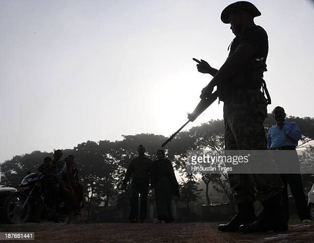 Paramilitary police guards a polling booth during the first phase of assembly elections of Chhattisgarh at Jagadalpur on November 11 2013 in Bastar...