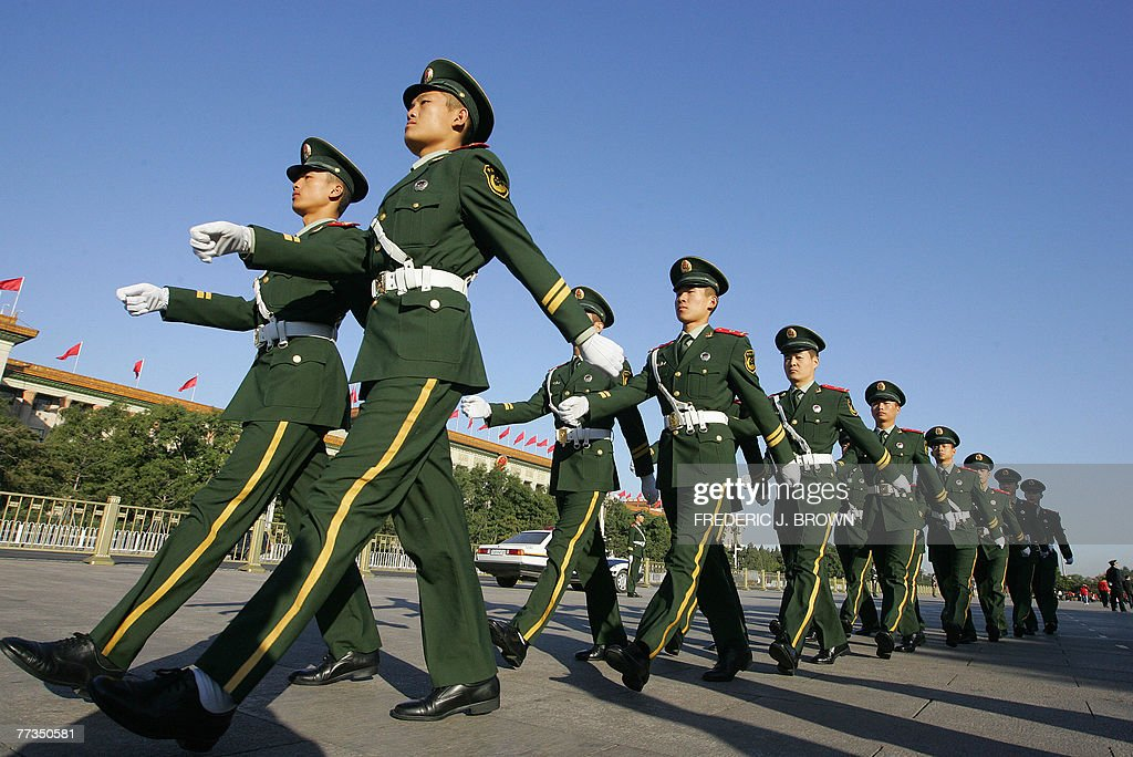 Paramilitary police march on Tiananmen Square across from the Great Hall of the People in Beijing, 16 October 2007, on the second day of the ruling Chinese Communist Party's 17th five-yearly Congress. China's communists have left nothing to chance during the Congress with hundreds of police and other security forces posted outside the ironically named Great Hall of the People, which generally excludes 'the people', unless they are party members. AFP PHOTO/Frederic J. BROWN