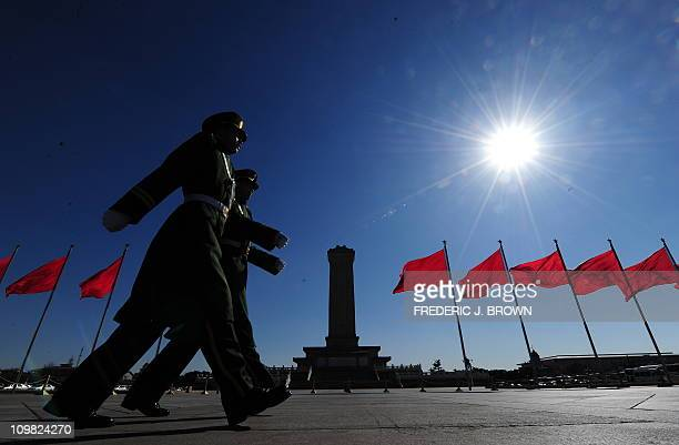 Paramilitary police march past the Monument to the People's Heroes on Tiananmen Square closed off to the general public during ramped up security for...