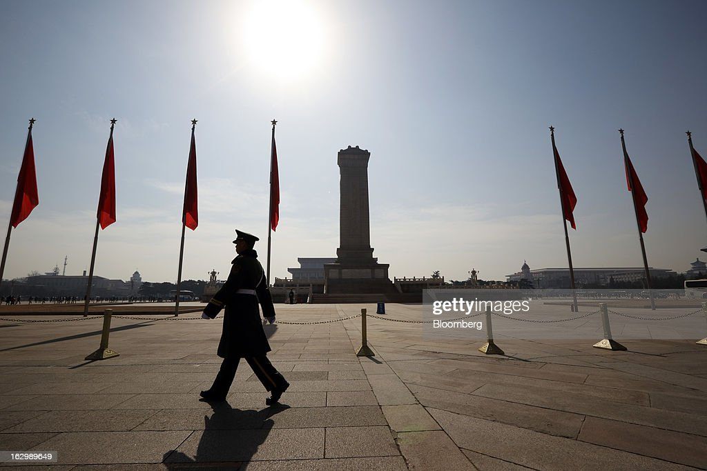 A paramilitary police officer patrols at Tiananmen Square in Beijing, China, on Sunday, March 3, 2013. Premier Wen Jiabao will this week formally announce this year's economic targets when he delivers his final work report to the National People's Congress, which begins on March 5. Photographer: Tomohiro Ohsumi/Bloomberg via Getty Images