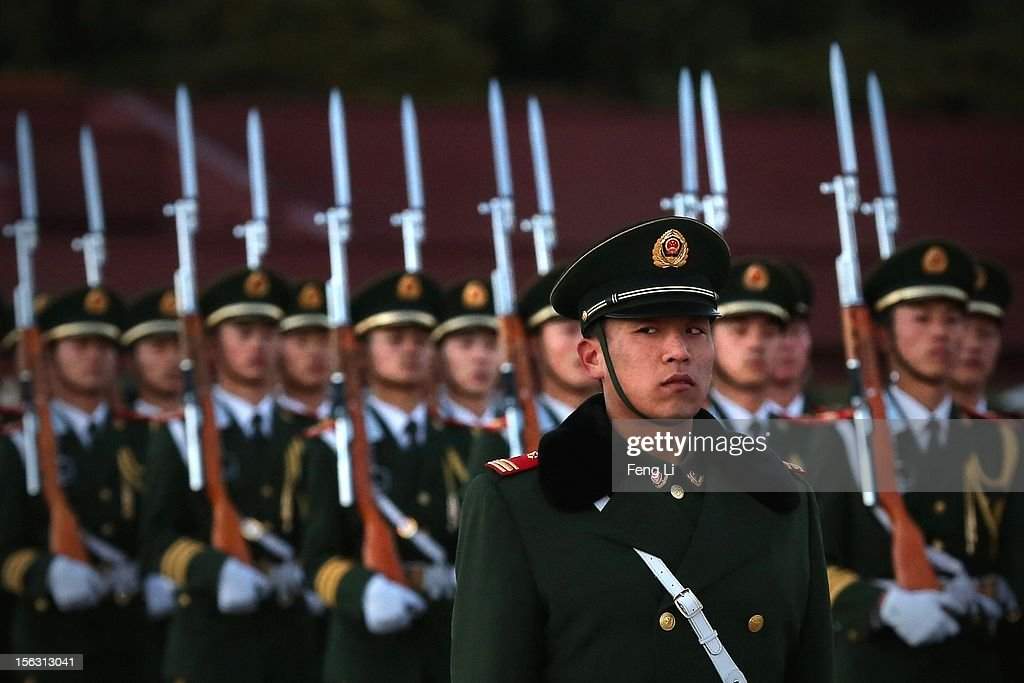 A paramilitary police officer stand guard during the flag-lowering ceremony at the Tiananmen Square on November 13, 2012 in Beijing, China. The 18th National Congress of the Communist Party of China (CPC) will close Wednesday morning after electing members and alternate members of a new CPC Central Committee and members of a new Central Commission for Discipline Inspection.
