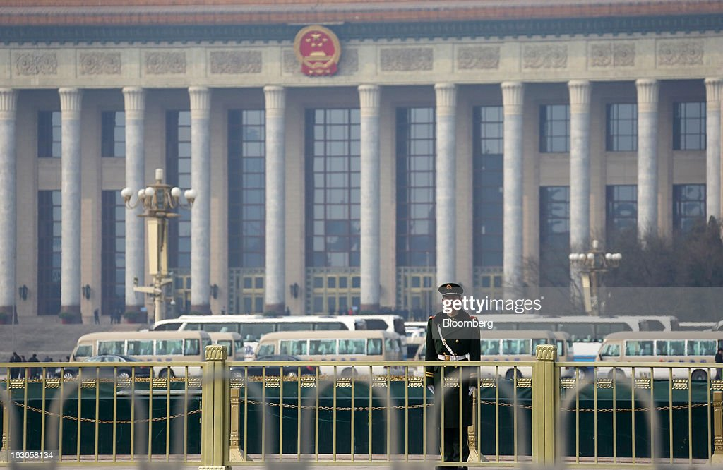 A paramilitary police officer stands guard in front of the Great Hall of the People in Beijing, China, on Thursday, March 14, 2013. Xi Jinping was named China's president by the national legislature, replacing Hu Jintao in the country's most rapid formal transfer of power in more than a generation. Photographer: Tomohiro Ohsumi/Bloomberg via Getty Images
