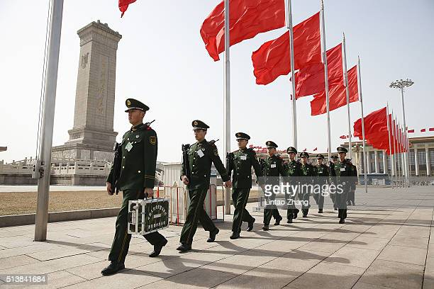 Paramilitary police officer stands guard in front of the Great Hall of the People during the opening session of the National People's Congress on...