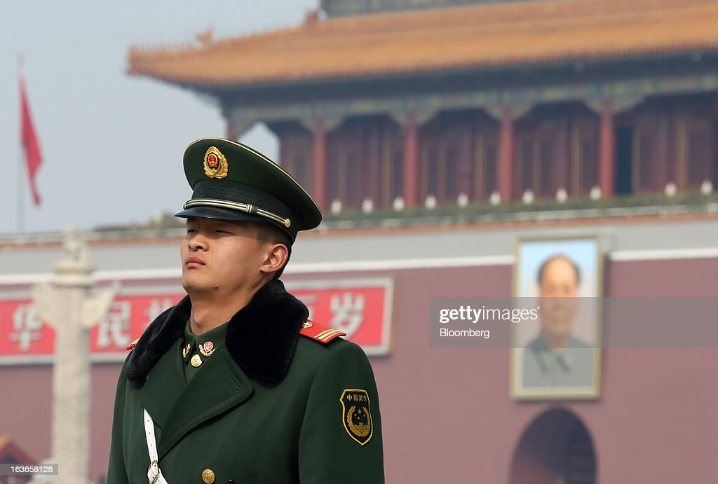 A paramilitary police officer stands guard in front of Tiananmen Gate in Beijing, China, on Thursday, March 14, 2013. Xi Jinping was named China's president by the national legislature, replacing Hu Jintao in the country's most rapid formal transfer of power in more than a generation. Photographer: Tomohiro Ohsumi/Bloomberg via Getty Images