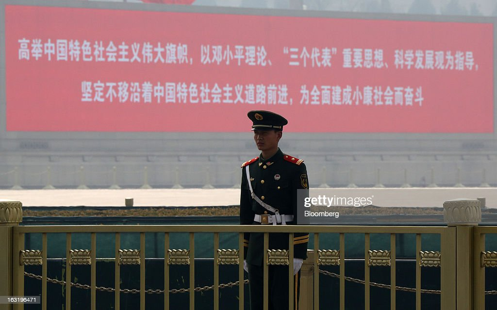 A paramilitary police officer stands guard outside Tiananmen Square in Beijing, China, on Wednesday, March 6, 2013. China maintained its economic-growth target at 7.5 percent for 2013 while setting a lower inflation goal of 3.5 percent, setting up a challenge for new leaders to keep prices in check without harming expansion. Photographer: Tomohiro Ohsumi/Bloomberg via Getty Images