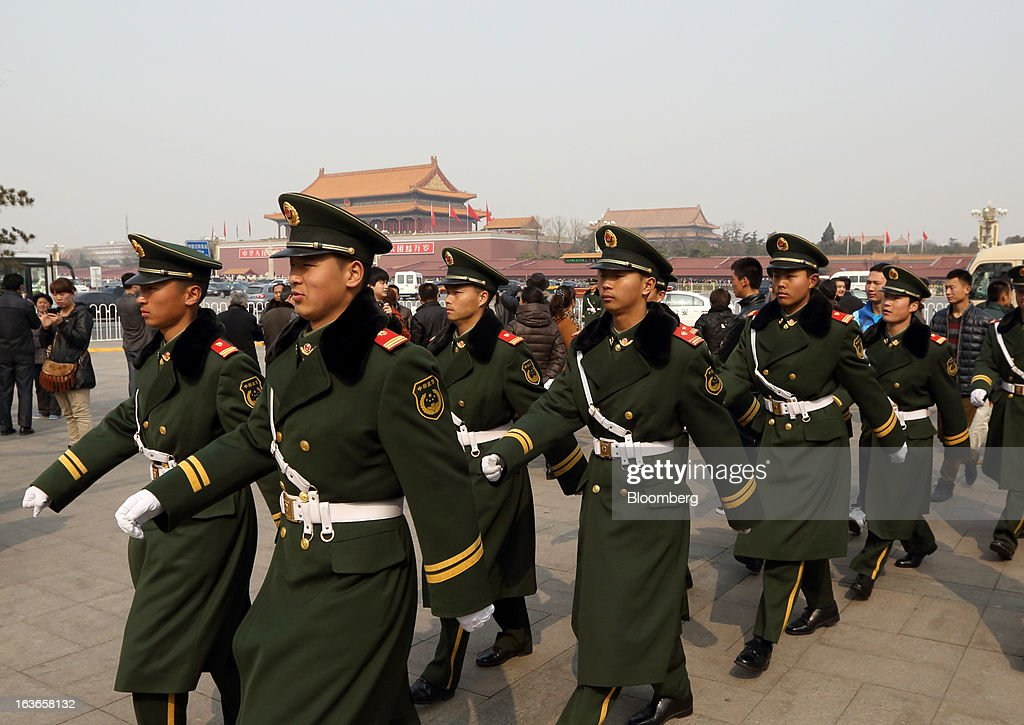 Paramilitary police officers march in front of Tiananmen Gate in Beijing, China, on Thursday, March 14, 2013. Xi Jinping was named China's president by the national legislature, replacing Hu Jintao in the country's most rapid formal transfer of power in more than a generation. Photographer: Tomohiro Ohsumi/Bloomberg via Getty Images