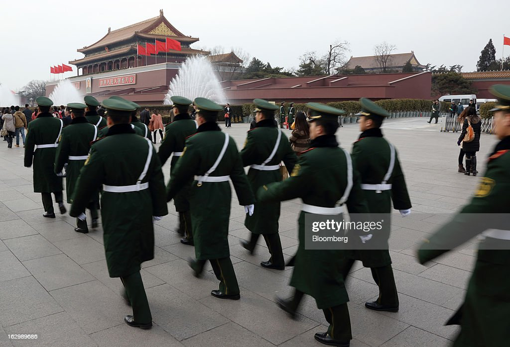 Paramilitary police officers march past Tiananmen Gate in Beijing, China, on Saturday, March 2, 2013. Premier Wen Jiabao will this week formally announce this year's economic targets when he delivers his final work report to the National People's Congress, which begins on March 5. Photographer: Tomohiro Ohsumi/Bloomberg via Getty Images
