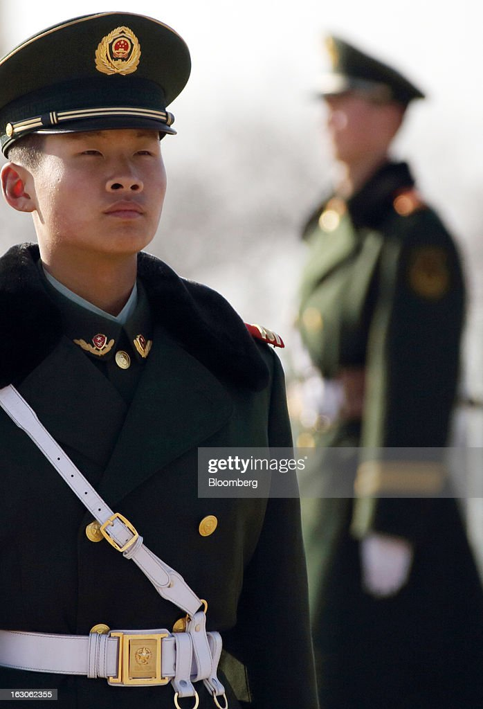 Paramilitary police officers stand guard at Tiananmen Square in Beijing, China, on Monday, March 4, 2013. Premier Wen Jiabao will this week formally announce this year's economic targets when he delivers his final work report to the National People's Congress, which begins on March 5. Photographer: Tomohiro Ohsumi/Bloomberg via Getty Images