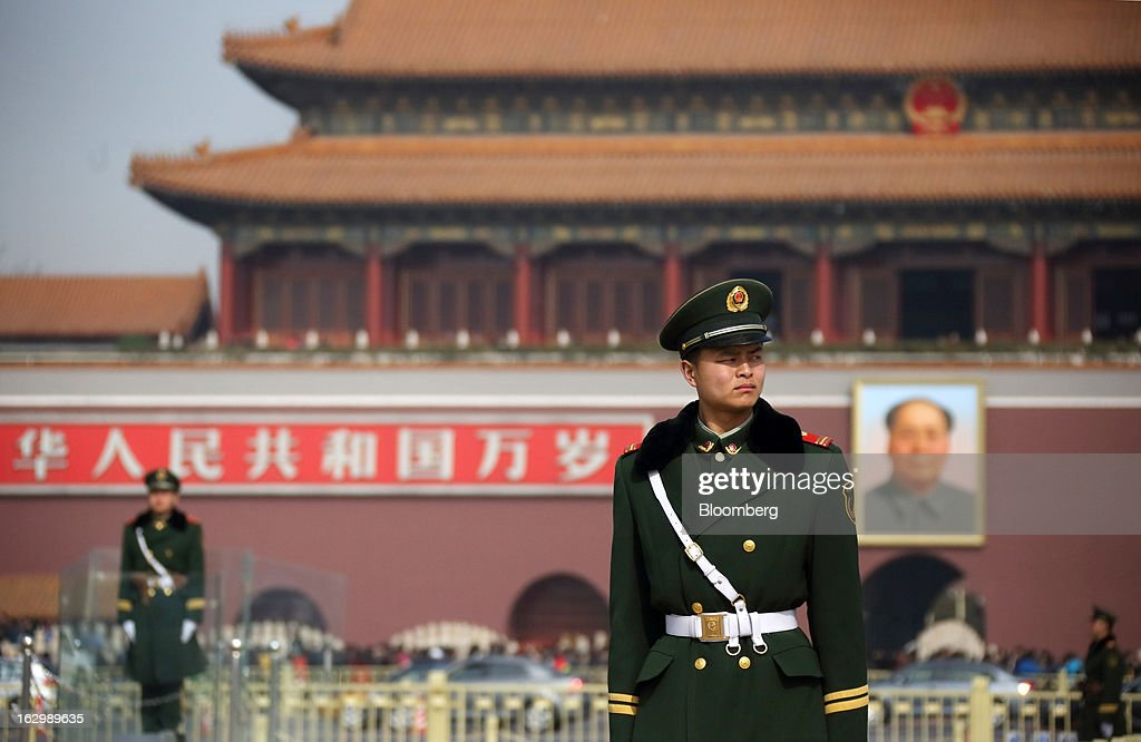 Paramilitary police officers stand guard in front of Tiananmen Gate in Beijing, China, on Sunday, March 3, 2013. Premier Wen Jiabao will this week formally announce this year's economic targets when he delivers his final work report to the National People's Congress, which begins on March 5. Photographer: Tomohiro Ohsumi/Bloomberg via Getty Images