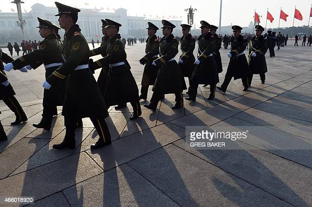 Paramilitary police patrol in Tiananmen Square next to the Great Hall of the People where the annual session of China's legislature the National...