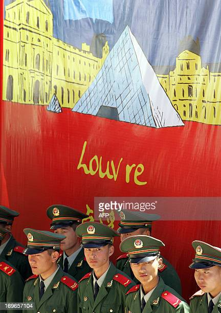 Paramilitary police stand guard beside festive decorations marking the close of the Year of France in China 17 September 2005 at the Badaling section...