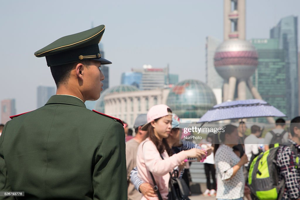 A paramilitary police stands guard by the Bund during the Labour Day holidays in Shanghai on May 1 2016.
