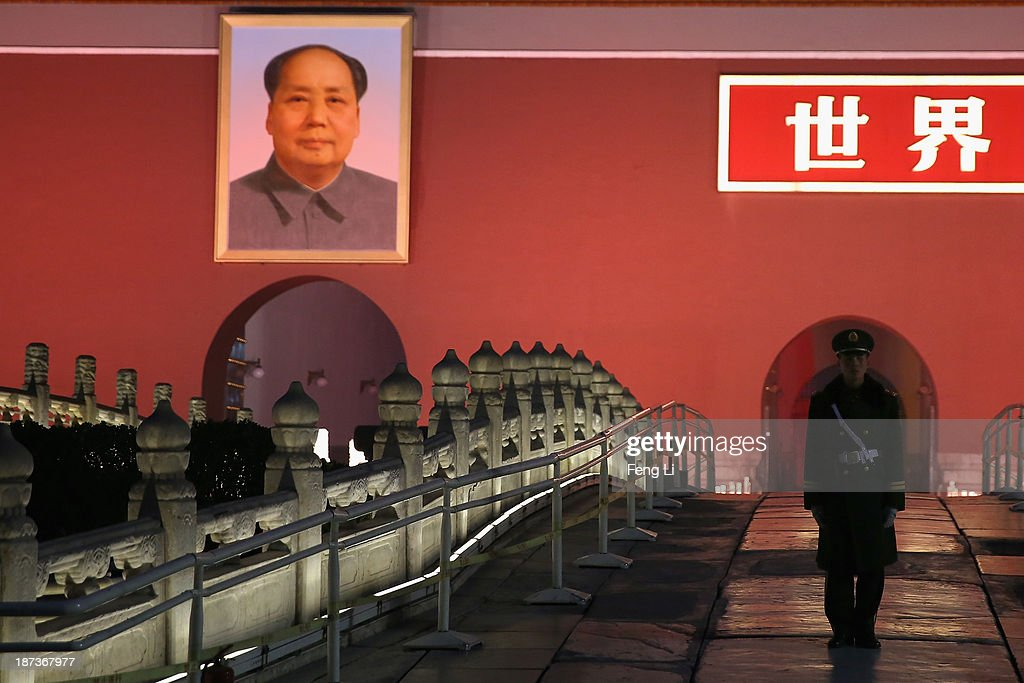 A paramilitary policeman guards in front of Tiananmen Gate on November 8, 2013 in Beijing, China. The Communist Party of China (CPC) will convene the Third Plenary Session of the 18th CPC Central Committee from November 9 to 12 to discuss comprehensively deepening reforms.