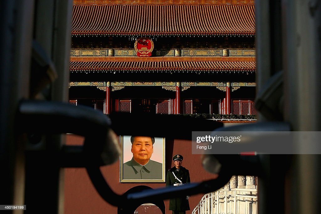 A paramilitary policeman guards in front of Tiananmen Gate on November 17, 2013 in Beijing, China. The full text of the Communist Party of China (CPC) Central Committee's decision on major issues concerning comprehensively deepening reforms was issued on Friday. The decision was approved at the Third Plenary Session of the 18th CPC Central Committee held from November 9 to 12 in Beijing.