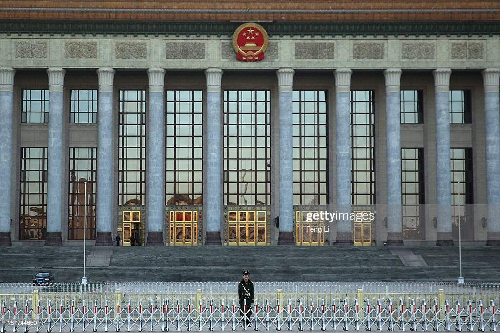 A paramilitary policeman guards outside the Great Hall of the People where the Communist Party's 205-member Central Committee gathered for its third annual plenum on November 12, 2013 in Beijing, China. The 18th Central Committee of the Communist Party of China (CPC) approved a decision on 'major issues concerning comprehensively deepening reforms' at the close of the Third Plenary Session of the 18th CPC Central Committee on Tuesday.