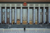 A paramilitary policeman guards outside the Great Hall of the People where the Communist Party's 205member Central Committee gathered for its third...