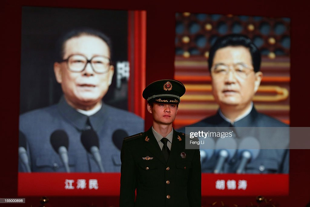 A paramilitary policeman passes the portraits of China's President Hu Jintao and former President Jiang Zeming as visiting an exhibition entitled 'Scientific Development and Splendid Achievements' before the18th National Congress of the Communist Party of China (CPC) on October 30, 2012 in Beijing, China. The exhibition showcases China's progress in political, economic, cultural and ecological spheres over the past decade. The18th National Congress of the Communist Party of China (CPC) is proposed to convene on November 8 in Beijing.
