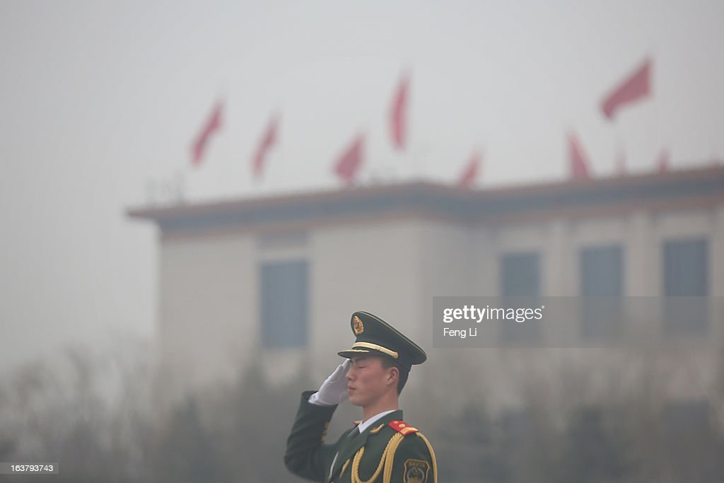 A paramilitary policeman salutes outside the Great Hall of the People at Tiananmen Square after the sixth plenary meeting of the National People's Congress at the Great Hall of the People on March 16, 2013 in Beijing, China. The new lineup of China's State Council, nominated by Premier Li Keqiang, was endorsed by lawmakers at the ongoing national legislative session Saturday afternoon.