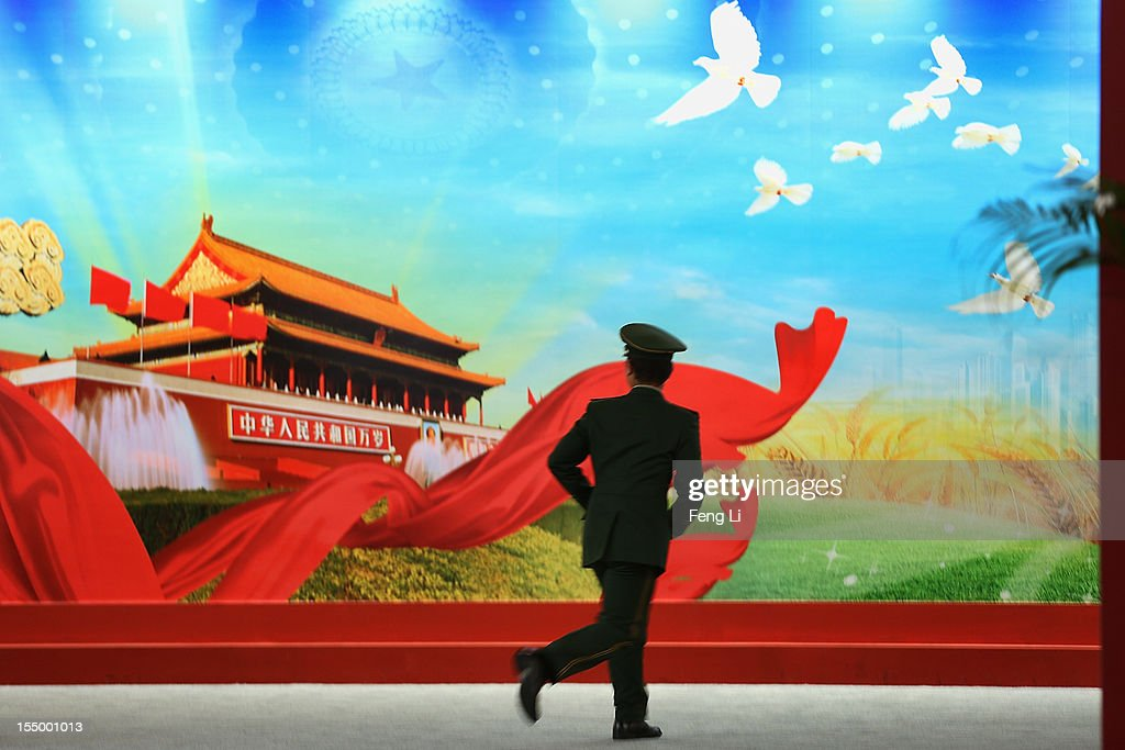 A paramilitary policeman visits an exhibition entitled 'Scientific Development and Splendid Achievements' before the18th National Congress of the Communist Party of China (CPC) on October 30, 2012 in Beijing, China. The exhibition showcases China's progress in political, economic, cultural and ecological spheres over the past decade. The18th National Congress of the Communist Party of China (CPC) is proposed to convene on November 8 in Beijing.
