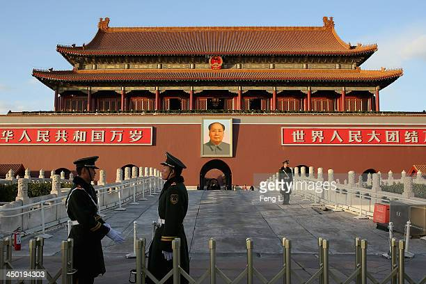 Paramilitary policemen guard in front of Tiananmen Gate on November 17 2013 in Beijing China The full text of the Communist Party of China Central...