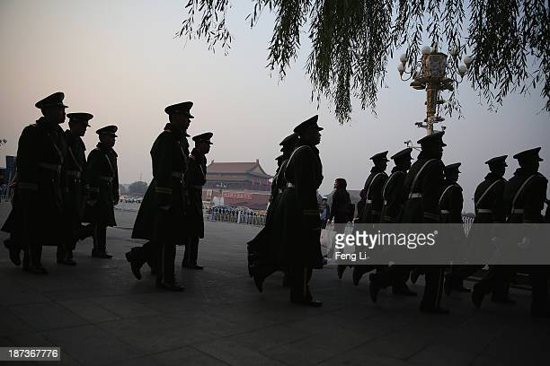 Paramilitary policemen patrol at Tiananmen Square on November 8 2013 in Beijing China The Communist Party of China will convene the Third Plenary...