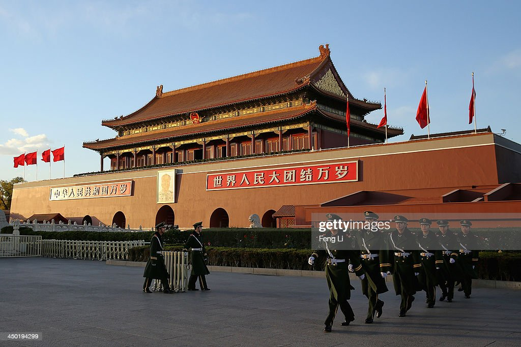 Paramilitary policemen patrol in front of Tiananmen Gate on November 17, 2013 in Beijing, China. The full text of the Communist Party of China (CPC) Central Committee's decision on major issues concerning comprehensively deepening reforms was issued on Friday. The decision was approved at the Third Plenary Session of the 18th CPC Central Committee held from November 9 to 12 in Beijing.