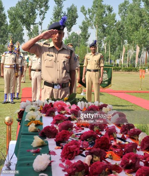 A paramilitary soldier salutes as he pays tribute to slain paramilitary Central Reserve Police Force SubInspector Sahab Shukla during the wreath...